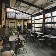 rooftop bar with dinner seating at Strada Italiano