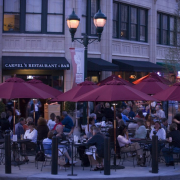 Guests enjoying dinner on the patio at Carmels in The Grove Arcade