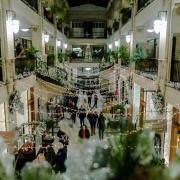Christmas lights hanging inside of the Grove Arcade