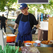 Owner of Luella's Bar-B-Que cooking at food festival