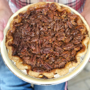 Holding a pecan pie from Baked Pie Company
