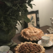 warm pies on table with coffee cups