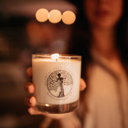 woman holding lit candle from Element Tree Essentials