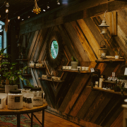 wood pallet wall with mirror and products at Element Tree Essentials