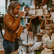 woman smelling candle at Element Tree Essentials