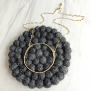 gold circle necklace from Embellish Asheville