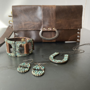 matching jewelry and leather bag from Embellish Asheville