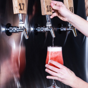 Pouring a beer off the tap at Hi-Wire Brewing
