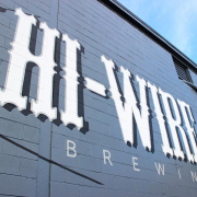 Hi-Wire Brewing Logo on building